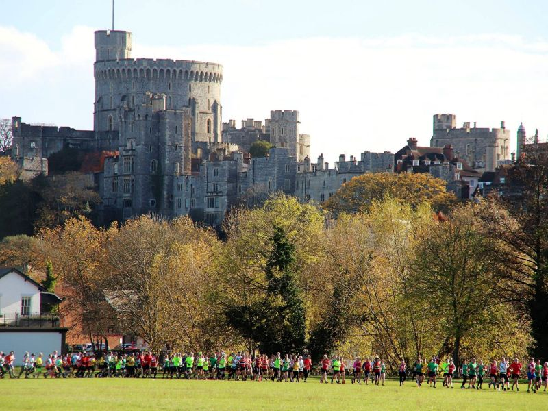 Runners on the Brocas, Eton, with Windsor Castle in the distance