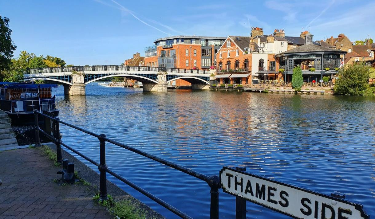 View across the River Thames of Eton from Windsor showing the pedestrian bridge