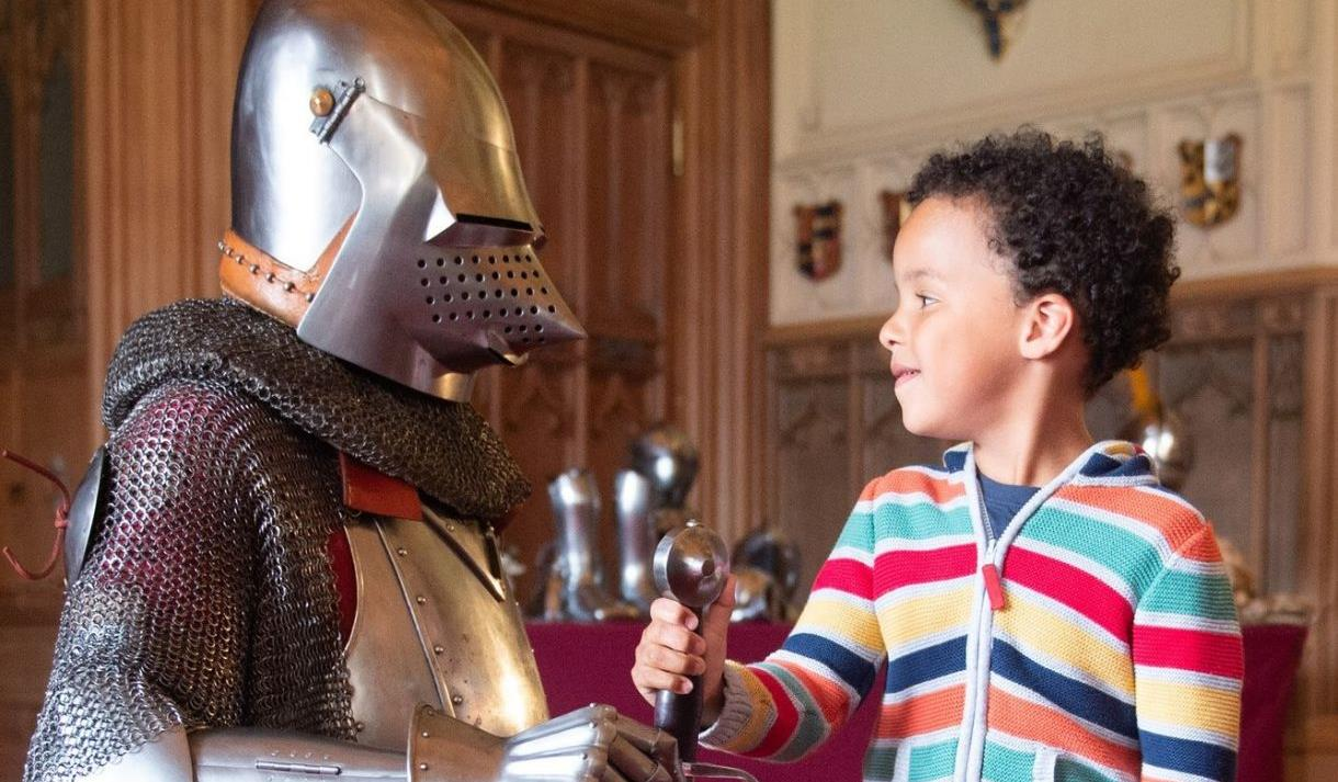Charge the Castle! family activity at Windsor Castle.  Boy with armour