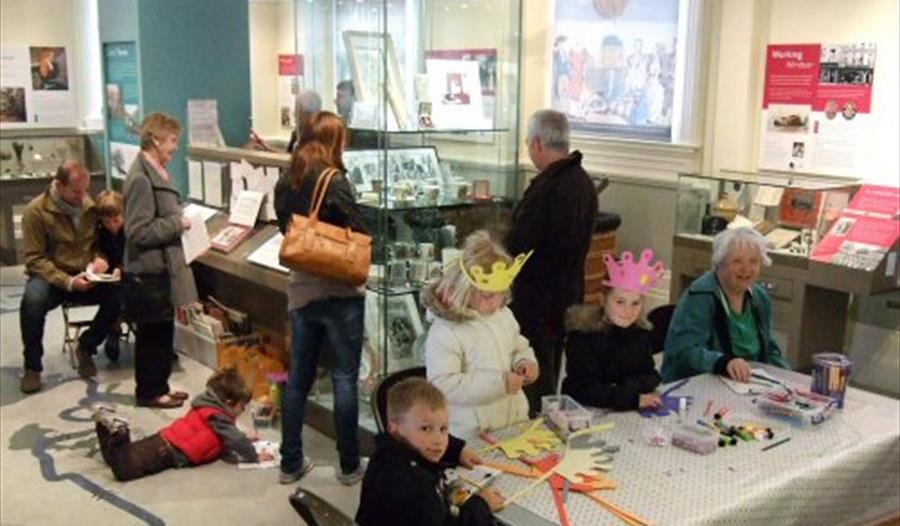 Visitors enjoying activities at the Museum