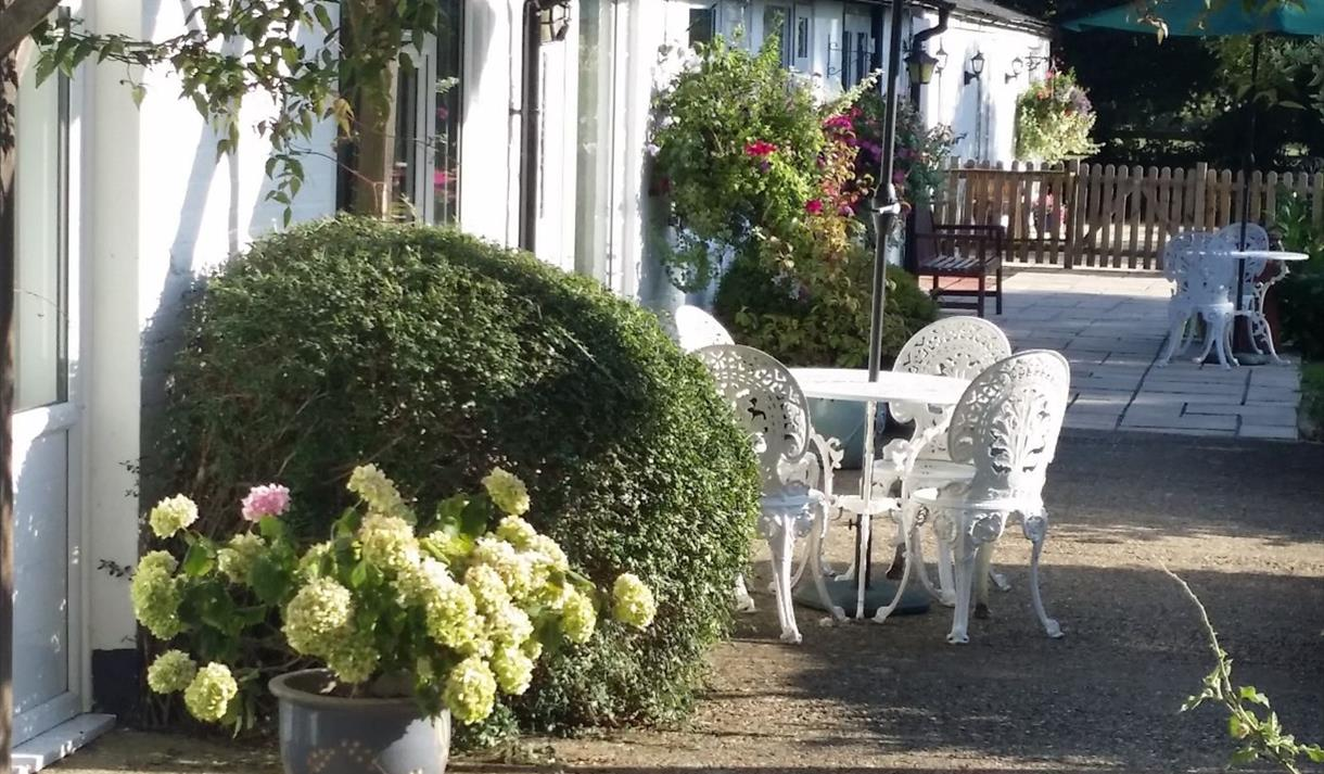 Patio outside Sheephouse Manor Cottages: Enjoy a refreshing glass of wine, watching the lake view  sunset