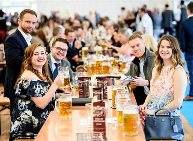 Group enjoying beer at Ascot Racecourse: Autumn Racing Weekend & Ascot Beer Festival